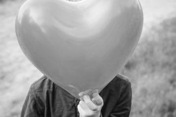 behind balloon